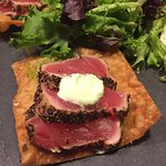 Tuna seared over wonton tostada with Asian guacamole, wakimi, ginger and wasabi sour cream