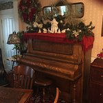 Piano in parlor with Robinson's (founders) photo to the right!