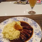 A hearty meal of smoked ham, mash and sauerkraut with a local beer.
