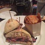 Pastrami sandwich with house-made potato chips.