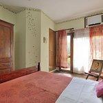 Nawab room with Queen size bed - door leading to balcony