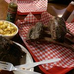 The full rack of beef ribs is so big it would take 3 hungry men to eat them.