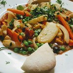 Tagine D'atlas Vegetarian with green peas, Artichokes hearts, potatoes and carrots with preserve