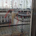 The hotel had decorated the room with balloons and Happy Birthday messages on the windows and mi