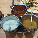 Complimentary sauces served on each table