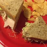 Cozy lil' place, great sandwich: Gotta Try This=roasted turkey breast w/ avocado, sprouts & sun-