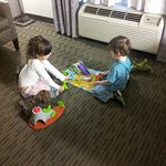 Our kiddos playing with the toys which the hotel manager purchased for them.