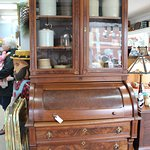 Beautiful early 1900's Walnut bookcase with a drum desk & draws