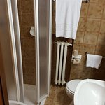 Bathroom was from a cruise ship! Could barely use the toilet without touching the hot radiator.