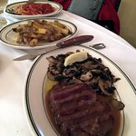 Filet Mignon with mushrooms and sauce, fries, and side spaghetti