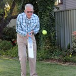 90 year old playing cricket in spacious back yard