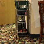 This hotel breakfast area is trash. They even made the coffee on the floor. And the guy in the w