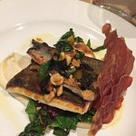 sea bass with celeriac puree, chard, crispy parma ham and toasted hazelnuts
