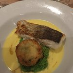 Roasted Hake with a potato cake, pea puree and beurre blanc