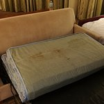 The sleeper sofa contained a mattress that was so filthy and stained it couldn't be used.