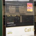 Lloyds Fish and Chip Shop - the signage outside the main entrance indicating their award