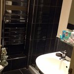 Our modern bathroom with light up mirror