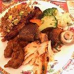 BBQ ribs, baked salmon, Peking chicken, fried rice and veggies