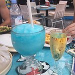 Ice Blue Cozumel and a glass of white wine