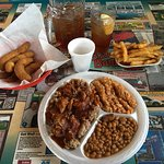 Some chopped (BBQ), red slaw and baked beans, that's real sweet tea in the back!
