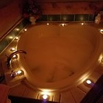 Simply gorgeous,it's so cozy,relaxing,and romantic. This was in a honeymoon cabin.