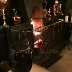 Enjoying a glass of vino by the open fire