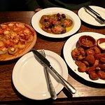 Pulpo feira, ensalada de tomate and patatas bravas