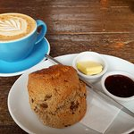 Delicious perfection- fruit scone and cappuccino