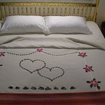 the room boys decorated our king its bed spread with flower paddles,amazing