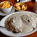 HALF ORDER OF SAUSAGE GRAVY ON BISCUITS AND SIDE ORDER OF CHEESY GRITS.