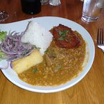 Peruvian stew of potatoes & pork with rice and yucca