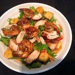 Amazing tasting Jerk salad combo with jerk shrimp and Jerk chicken