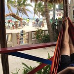 Porch of our room with hammock. Direct view on street and beach.