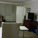 Living room, fridge, TV,. LG crn desk w/ chair. Bath Rm between bdrm & LR.