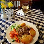 Greek Beef Stew on a bed of rice and served with roast potatoes and vegetables,