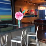 WXYZ bar seating with pool table in the background