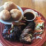 Authentic Jerk Chicken with a side of slaw and Johnny Cakes
