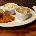 The vienna schnitzel! Handbreaded veal fried in real butter, comes with two different potato sal
