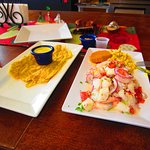 Mixed seafood ceviche with mashed plantains
