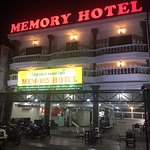 Front of hotel at night.