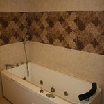 Hill view suite room with Jacuzzi sytem bath tub.