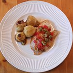 Salted Cod with a Tomato, Caper sauce served with Carmelized onions