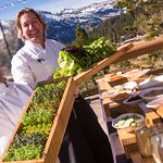 Our Executive Chef and culinary team member hold greens from the resort's on-site garden