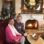 Guests enjoy the fire place in the parlor on a chilly day.