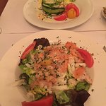 Seafood salad starter with smoked salmon, prawns, calamari and green salad, big enough to be a m