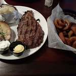 Ribeye Steak (12 oz.) meal with baked potato & onion rings
