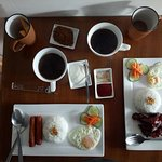 Breakfast with unlimited coffee + Room coffee at Daj Suites. For the hungry and adventurous coup