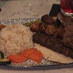 Grilled vegetables, rice, kabobs, lamb chop