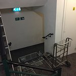 Luggage trollies left in a fire exit.