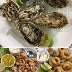Fresh oysters with some fried shrimps and squids.